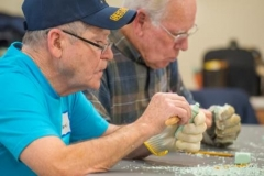 Cornbelt Carving Club demonstration and instruction at the Normal Activities and Recreation Center.